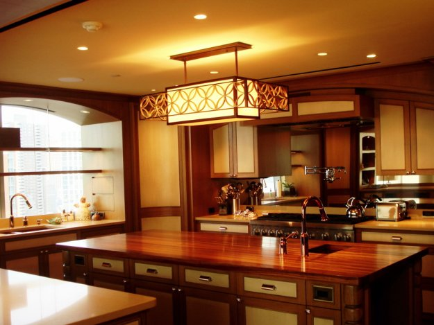Kitchen featuring Murray Feiss decorative, pendant mounted lighting, pinhole accent adjustable downlights, and LED undercabinet pucklights