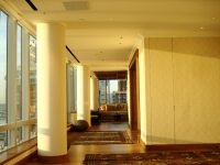 While full height windows provide beautiful lighting at sunset, mechanized shades can control and filter the daylight